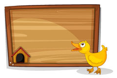 An empty board with a yellow duckling Royalty Free Stock Photography