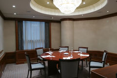 Empty boardroom. Boardroom with round meeting table Stock Photos