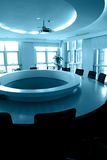 Empty boardroom with round table. Empty boardroom, with round table in the center,and a projector above Royalty Free Stock Image