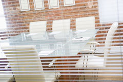 Empty boardroom through a window stock images