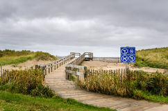 Empty Boardwalk to the ocean. Boardwalk to the beach on a windy and cloudy autumn day. Shediac, New Brunswick, Canada Stock Images