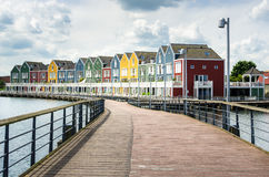 Empty Boardwalk to Waterside Wooden Row Houses Royalty Free Stock Image
