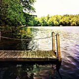 Dock. An empty boat dock on a lake Stock Photography