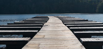 Empty boat docks and moorings after boats are removed stock image