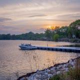 Empty boat on lake at sunrise. Empty boat sitting on Lake at sunset Royalty Free Stock Photos