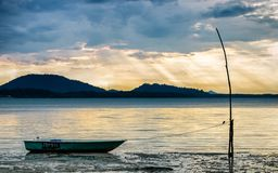 Empty boat parked under sun ray sky royalty free stock images