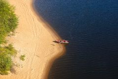 Empty boat on the river bank. View from above. A lonely boat on a sandy beach Royalty Free Stock Photography