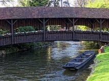 Boat under wooden bridge idyllic scenery at spring Stock Photos