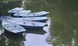 Empty boats moored to the shore Stock Photography