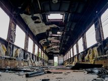Empty bogey of the retired train with rusty debris and garbage inside. Empty bogey of the retired train with a lot of rusty debris and garbage inside Stock Photography