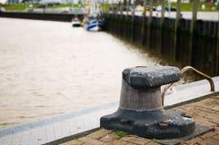 Empty bollard in Bensersiel-Harbour Royalty Free Stock Image