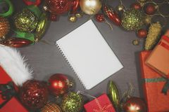 Empty book with Christmas ornaments. Top view of an empty book with Christmas ornaments on the wooden table Stock Photography