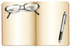 An empty book with an eyeglass and a ballpen Royalty Free Stock Photo