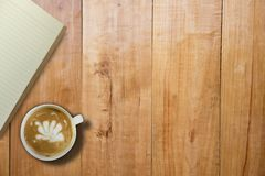 Empty book and hot coffee over wooden board table, copy space fo. R presentation product, mock up Stock Photography