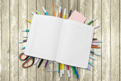 Empty book over school supplies on the table Royalty Free Stock Photo