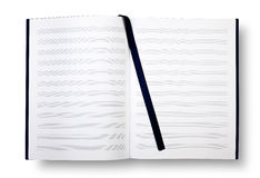 Empty book with pentagrams or score. Empty exercise book with pentagrams, bookmark on white and shadow Royalty Free Stock Photos