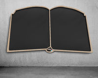 Empty book shape blackboard on wall Stock Images