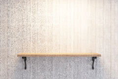 Empty book shelf. On wooden wall Royalty Free Stock Image