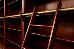 Empty bookcase with ladder Royalty Free Stock Photos