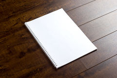Empty booklet. On wood Royalty Free Stock Images