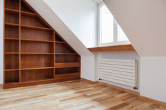 Empty bookshelf in the attic