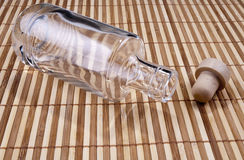 Empty bottle. On the bamboo background Stock Photography