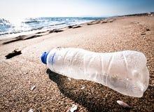 Empty bottle. At a beach in italy - grado Stock Image
