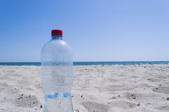 Empty bottle on the background of the sea. With a blue sky Stock Photos