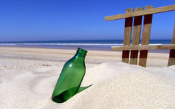 Empty bottle on the beach Royalty Free Stock Photography