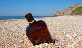 Empty bottle on beach Royalty Free Stock Image