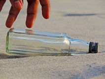 Empty bottle on the beach stock images