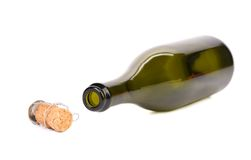 Empty bottle of champagne and muzzle with cork. Stock Images