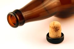 Empty bottle and cork. Empty brown bottle mouth and cork on white background stock photography