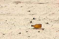 Empty bottle in desert Royalty Free Stock Images