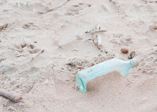 Empty bottle. Empty glass bottle in the sand Stock Photos