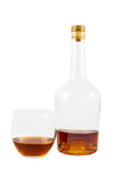 Almost empty bottle and glass of whiskey Royalty Free Stock Photo