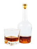 Almost empty bottle and glass of whiskey Stock Photos
