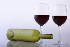 Empty bottle and glasses of red wine Stock Images