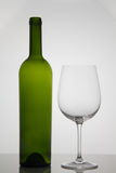 Empty bottle of wine with empty glass of wine on white background Stock Photos