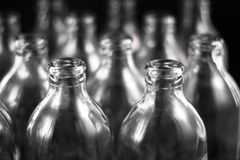 Empty bottles. Collection, colorless, isolated on black background Royalty Free Stock Photography