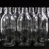 Empty bottles. Collection, colorless, isolated on black background Royalty Free Stock Image