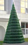 Empty bottles of champagne stacked in pyramid near factory of sparkling wines in village of Abrau Durso, Russia Stock Photo