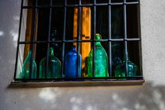 Empty bottles exposed on the windowsill . Empty bottles exposed on the windowsill and lit by the sun Royalty Free Stock Photo
