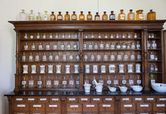 Empty bottles in old vintage pharmacy. Empty chemical bottles in old vintage pharmacy royalty free stock photography