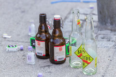 Empty Bottles. Stuttgart, Germany - July 27th, 2013 - Empty beer and shot bottles on the ground after the Christopher Street Day (CSD) parade in Stuttgart in Stock Photos