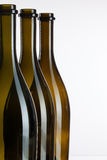Empty bottles of wine on a glass desk Stock Images