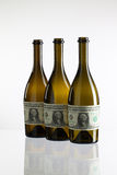 Empty bottles of wine from the label of dollar bill Royalty Free Stock Image