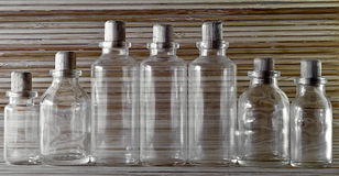 Empty bottles on wooden background. Picture of Empty bottles on wooden background Royalty Free Stock Photo