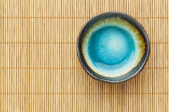 Empty bowl and bamboo mat Stock Photo