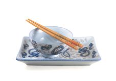 Empty bowl, dish and chopsticks Royalty Free Stock Image